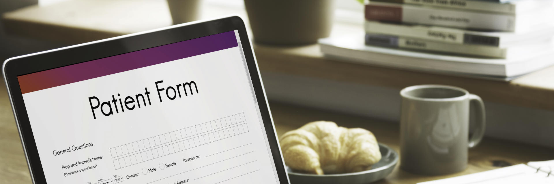 E-patient form displayed on a laptop screen.