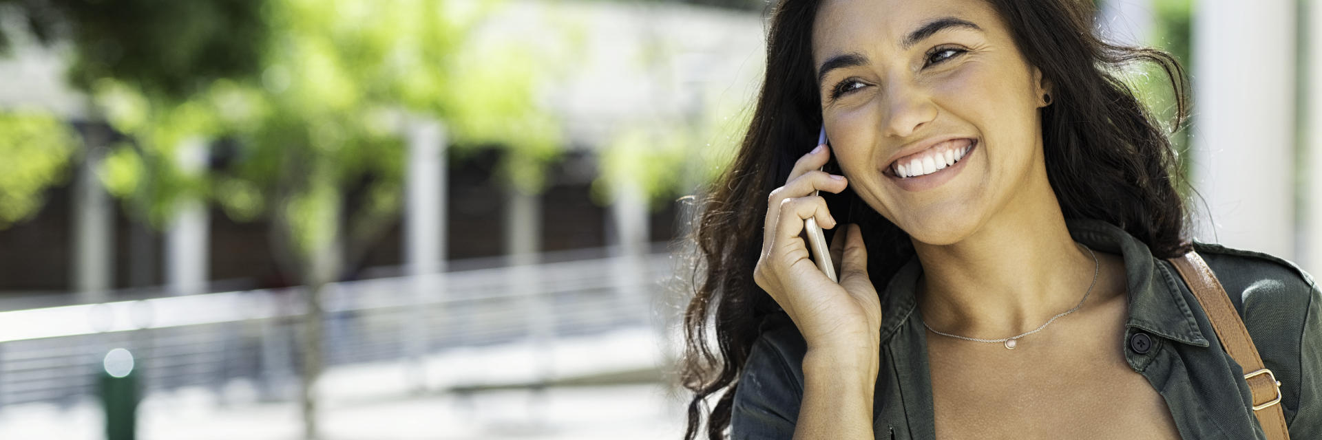 A cheerful woman talking on the phone.