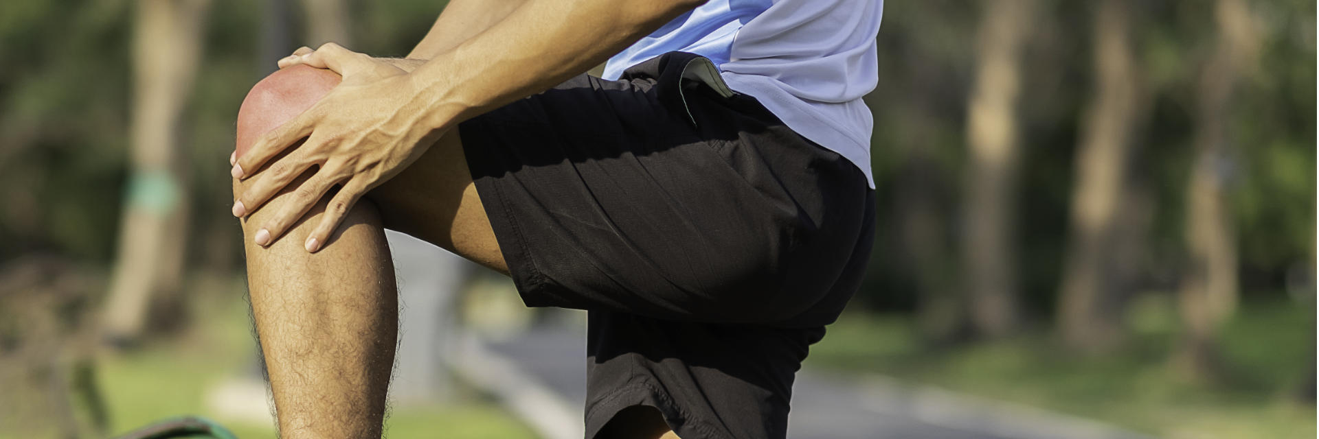 A runner touching the painful knee joint.