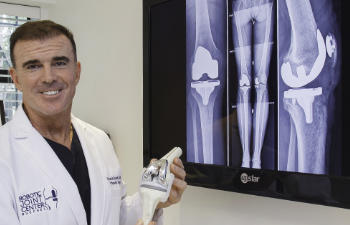 Dr. Buechel presenting post-operative x-rays of a patient after total knee replacement